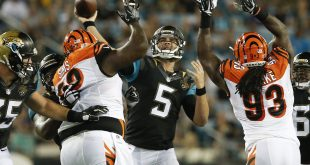 Aug 28, 2016; Jacksonville, FL, USA;  Jacksonville Jaguars quarterback Blake Bortles (5) makes a pass against Cincinnati Bengals defensive end Will Clarke (93) and linebacker Trevor Roach (52) during the second quarter of a football game at EverBank Field. Mandatory Credit: Reinhold Matay-USA TODAY Sports