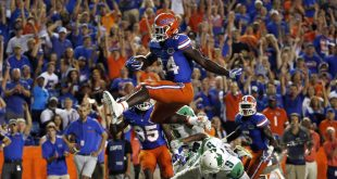 Sep 17, 2016; Gainesville, FL, USA; Florida Gators running back Mark Thompson (24) jumps over North Texas Mean Green defensive back Nate Brooks (9) to score a touchdown during the second half at Ben Hill Griffin Stadium. Florida Gators defeated the North Texas Mean Green 32-0. Mandatory Credit: Kim Klement-USA TODAY Sports