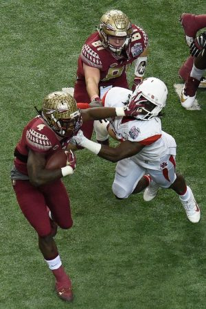 Dec 31, 2015; Atlanta, GA, USA; Florida State Seminoles running back Dalvin Cook (4) carries the ball as Houston Cougars Houston Cougars linebacker Steven Taylor (41) defends during the first quarter in the 2015 Chick-fil-A Peach Bowl at the Georgia Dome. Mandatory Credit: Dale Zanine-USA TODAY Sports
