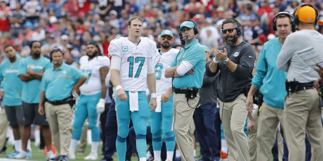 Sep 18, 2016; Foxborough, MA, USA; Miami Dolphins quarterback Ryan Tannehill (17) and Miami Dolphins head coach Adam Gase on the sideline as they take on the New England Patriots in the second half at Gillette Stadium. The Patriots defeated the Miami Dolphins 31-24. Mandatory Credit: David Butler II-USA TODAY Sports