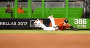 Aug 28, 2016; Miami, FL, USA; Miami Marlins left fielder Christian Yelich (21) is unable to make a catch during the second inning against the San Diego Padres at Marlins Park. Mandatory Credit: Steve Mitchell-USA TODAY Sports