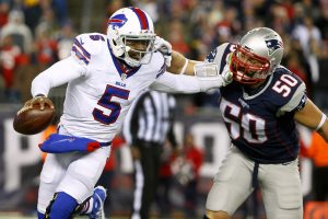 Nov 23, 2015; Foxborough, MA, USA; Buffalo Bills quarterback Tyrod Taylor (5) tries to break free from New England Patriots defensive end Rob Ninkovich (50) during the second half at Gillette Stadium. Mandatory Credit: Winslow Townson-USA TODAY Sports