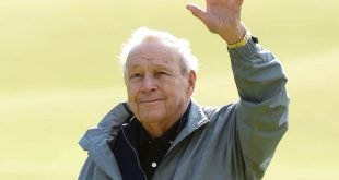 Jul 15, 2015; St. Andrews, Fife, GBR;  Arnold Palmer takes the applause from the fans on the 18th green at the end of the Champions challenge at the 144th Open Championship at The Old Course at the Royal and Ancient Golf Club of St Andrews. Mandatory Credit: Ian Rutherford-USA TODAY Sports