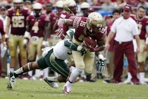 Sep 12, 2015; Tallahassee, FL, USA; Florida State Seminoles wide receiver Travis Rudolph (15) picks up a first down against the South Florida Bulls at Doak Campbell Stadium. Florida State won 34-14. Mandatory Credit: Glenn Beil-USA TODAY Sports