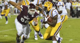 Sep 12, 2015; Starkville, MS, USA; LSU Tigers running back Leonard Fournette (7) is defended by Mississippi State Bulldogs defensive lineman Nick James (88) during the first quarter at Davis Wade Stadium. Mandatory Credit: Matt Bush-USA TODAY Sports