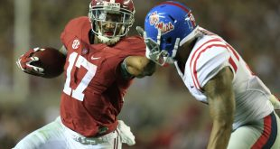 Sep 19, 2015; Tuscaloosa, AL, USA; Alabama Crimson Tide running back Kenyan Drake (17) pushes away Mississippi Rebels defensive back Kailo Moore (13) at Bryant-Denny Stadium. The Rebels defeated the Tide 43-37. Mandatory Credit: Marvin Gentry-USA TODAY Sports