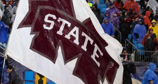 Dec 30, 2015; Charlotte, NC, USA; The Mississippi State Bulldogs flag is waved in the endzone after a score in the second quarter against the North Carolina State Wolfpack in the 2015 Belk Bowl at Bank of America Stadium. Mandatory Credit: Jeremy Brevard-USA TODAY Sports