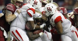 Dec 31, 2015; Atlanta, GA, USA; Florida State Seminoles running back Dalvin Cook (4) carries the ball as Houston Cougars defensive lineman Nick Thurman (91), defensive end Jerard Carter (52), and linebacker Elandon Roberts (44) tackle in the third quarter in the 2015 Chick-fil-A Peach Bowl at the Georgia Dome. The Cougars won 38-24. Mandatory Credit: Brett Davis-USA TODAY Sports