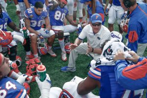Jan 1, 2016; Orlando, FL, USA; Florida Gators offensive line coach Mike Summers (right center) talks to his players during the second half against the Michigan Wolverines in the 2016 Citrus Bowl at Orlando Citrus Bowl Stadium. Michigan won 41-7. Mandatory Credit: Reinhold Matay-USA TODAY Sports