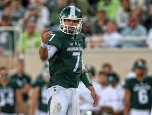 Sep 2, 2016; East Lansing, MI, USA; Michigan State Spartans quarterback Tyler O'Connor (7) gestures from the field during the first half against the Furman Paladins at Spartan Stadium. Mandatory Credit: Mike Carter-USA TODAY Sports