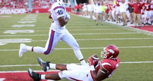 Sep 3, 2016; Fayetteville, AR, USA; Arkansas Razorbacks tight end Jeremy Sprinkle (83) catches a pass for a touchdown as Louisiana Tech Bulldogs defensive end Jaylon Ferguson (45) looks on at Donald W. Reynolds Razorback Stadium. Arkansas defeated Louisiana Tech 21-20. Mandatory Credit: Nelson Chenault-USA TODAY Sports