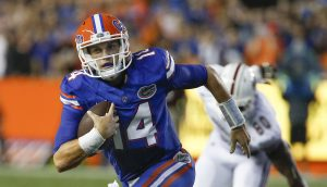 Sep 3, 2016; Gainesville, FL, USA; Florida Gators quarterback Luke Del Rio (14) keeps the ball and runs during the first quarter of a football game against the Massachusetts Minutemen at Ben Hill Griffin Stadium. Mandatory Credit: Reinhold Matay-USA TODAY Sports