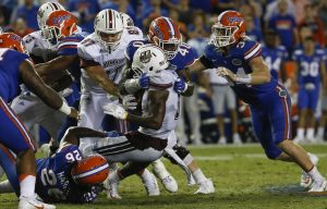 Sep 3, 2016; Gainesville, FL, USA; Florida Gators linebacker Jarrad Davis (40) and defensive back Marcell Harris (26) tackle Massachusetts Minutemen running back Marquis Young (8) during the second half of a football game against the at Ben Hill Griffin Stadium. The Gators won 24-7. Mandatory Credit: Reinhold Matay-USA TODAY Sports