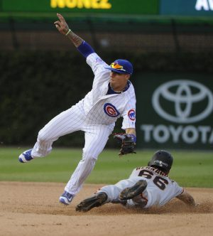 Sep 4, 2016; Chicago, IL, USA; Chicago Cubs third baseman Javier Baez (9) tags out San Francisco Giants center fielder Gorkys Hernandez (66) attempting to steal a base in the twelfth inning of their game at Wrigley Field. Mandatory Credit: Matt Marton-USA TODAY Sports