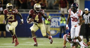 Sep 5, 2016; Orlando, FL, USA;  Florida State Seminoles running back Dalvin Cook (4) runs in the fourth quarter as Mississippi Rebels defensive back Zedrick Woods (36) defends at Camping World Stadium. Florida State Seminoles won 45-34. Mandatory Credit: Logan Bowles-USA TODAY Sports