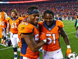 Sep 8, 2016; Denver, CO, USA; Denver Broncos linebacker Brandon Marshall (54) celebrates with linebacker Todd Davis (51) following the game against the Carolina Panthers at Sports Authority Field at Mile High. The Broncos defeated the Panthers 21-20. Mandatory Credit: Mark J. Rebilas-USA TODAY Sports