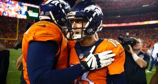 Sep 8, 2016; Denver, CO, USA; Denver Broncos quarterback Trevor Siemian (13) celebrates with tackle Donald Stephenson following the game against the Carolina Panthers at Sports Authority Field at Mile High. The Broncos defeated the Panthers 21-20. Mandatory Credit: Mark J. Rebilas-USA TODAY Sports