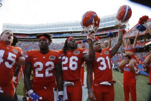 Sep 10, 2016; Gainesville, FL, USA; Florida Gators defensive back Teez Tabor (31), defensive back Marcell Harris (26), running back Lamical Perine (22) clearer after they beat the Kentucky Wildcats. Gators defeated the Kentucky Wildcats 45-7. Mandatory Credit: Kim Klement-USA TODAY Sports