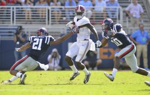 Sep 17, 2016; Oxford, MS, USA; Mississippi Rebels linebacker Terry Caldwell (21) and defensive end Marquis Haynes (10) attempt to tackle Alabama Crimson Tide wide receiver Calvin Ridley (3) during the second quarter of the game against the Alabama Crimson Tide at Vaught-Hemingway Stadium. Alabama won 48-43. Mandatory Credit: Matt Bush-USA TODAY Sports