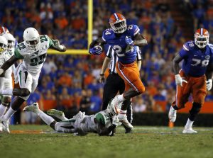 Sep 17, 2016; Gainesville, FL, USA; Florida Gators running back Mark Thompson (24) carries the ball over North Texas Mean Green defensive back James Gray (21) during the second half at Ben Hill Griffin Stadium. Florida Gators defeated the North Texas Mean Green 32-0. Mandatory Credit: Kim Klement-USA TODAY Sports