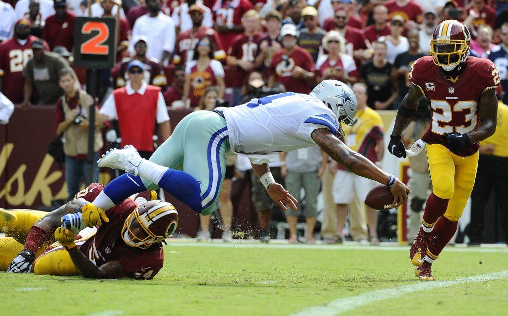 Sep 18, 2016; Landover, MD, USA; Dallas Cowboys quarterback Dak Prescott (4) scores a touchdown against the Washington Redskins during the second half at FedEx Field. The Dallas Cowboys won 27 - 23. Mandatory Credit: Brad Mills-USA TODAY Sports