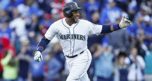 Sep 21, 2016; Seattle, WA, USA; Seattle Mariners second baseman Robinson Cano (22) celebrates following his game winning walk off sacrifice fly ball against the Toronto Blue Jays during the twelfth inning at Safeco Field. Seattle defeated Toronto 2-1. Mandatory Credit: Joe Nicholson-USA TODAY Sports