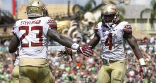 Sep 24, 2016; Tampa, FL, USA; Florida State Seminoles running back Dalvin Cook (4) and fullback Freddie Stevenson (23) celebrate after a touchdown in the second quarter against the South Florida Bulls at Raymond James Stadium. Mandatory Credit: Logan Bowles-USA TODAY Sports