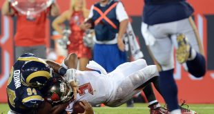 Sep 25, 2016; Tampa, FL, USA;  Tampa Bay Buccaneers quarterback Jameis Winston (3) gets tackled by Los Angeles Rams defensive end Robert Quinn (94) to end the game at Raymond James Stadium. Mandatory Credit: Jonathan Dyer-USA TODAY Sports