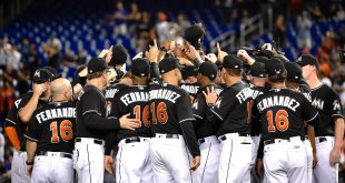 Sep 26, 2016; Miami, FL, USA; Miami Marlins players embrace on the pitchers mound honoring their Marlins starting pitcher Jose Fernandez who passed over the weekend prior to a game against the New York Mets at Marlins Park. Mandatory Credit: Steve Mitchell-USA TODAY Sports