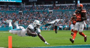 Sep 25, 2016; Miami Gardens, FL, USA; Miami Dolphins running back Damien Williams (26) dives into the end zone to score a touchdown in the game against the Cleveland Browns  during the second half at Hard Rock Stadium.The Miami Dolphins defeat the Cleveland Browns 34-20 in overtime.  Mandatory Credit: Jasen Vinlove-USA TODAY Sports