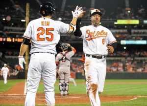 Sep 21, 2016; Baltimore, MD, USA; Baltimore Orioles second baseman Jonathan Schoop (6) celebrates with outfielder Hyun Soo Kim (25) after scoring a run in the third inning against the Boston Red Sox at Oriole Park at Camden Yards. Mandatory Credit: Evan Habeeb-USA TODAY Sports