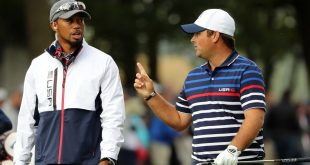Sep 29, 2016; Chaska, MN, USA; Team USA vice-captain Tiger Woods talks with Patrick Reed of the United States during a practice round for the 41st Ryder Cup at Hazeltine National Golf Club. Mandatory Credit: Rob Schumacher-USA TODAY Sports