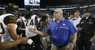 Sep 3, 2016; Lexington, KY, USA; Kentucky Wildcats head coach Mark Stoops shakes hands with Southern Mississippi Golden Eagles head coach Jay Hopson after the game at Commonwealth Stadium. Southern Mississippi defeated Kentucky 44-35. Mandatory Credit: Mark Zerof-USA TODAY Sports