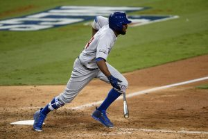 Oct 20, 2016; Los Angeles, CA, USA; Chicago Cubs center fielder Dexter Fowler (24) connects for a RBI single in the eighth inning against the Los Angeles Dodgers in game five of the 2016 NLCS playoff baseball series against the Los Angeles Dodgers at Dodger Stadium. Mandatory Credit: Gary A. Vasquez-USA TODAY Sports