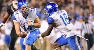 Oct 24, 2015; Starkville, MS, USA; Kentucky Wildcats quarterback Patrick Towles (14) hands off to Kentucky Wildcats running back Stanley Williams (18) during the game against the Mississippi State Bulldogs at Davis Wade Stadium. Mississippi State won 42-16. Mandatory Credit: Matt Bush-USA TODAY Sports