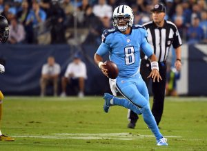 Oct 27, 2016; Nashville, TN, USA; Tennessee Titans quarterback Marcus Mariota (8) runs for a first down in the first half against the Jacksonville Jaguars at Nissan Stadium. Mandatory Credit: Christopher Hanewinckel-USA TODAY Sports