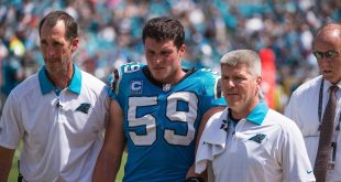 Sep 13, 2015; Jacksonville, FL, USA; Carolina Panthers middle linebacker Luke Kuechly (59) leaves the field after suffering a concussion during the game against the Jacksonville Jaguars at EverBank Field. The Panthers defeat the Jaguars 20-9. Mandatory Credit: Jerome Miron-USA TODAY Sports