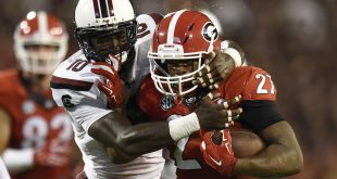 Sep 19, 2015; Athens, GA, USA; Georgia Bulldogs running back Nick Chubb (27) runs against South Carolina Gamecocks linebacker Skai Moore (10) during the second half at Sanford Stadium. Georgia defeated South Carolina 52-20. Mandatory Credit: Dale Zanine-USA TODAY Sports