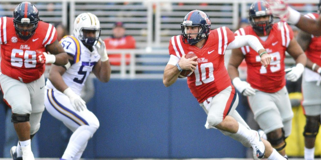 Nov 21, 2015; Oxford, MS, USA; Mississippi Rebels quarterback Chad Kelly (10) runs the ball during the first quarter of the game against the LSU Tigers at Vaught-Hemingway Stadium. Mandatory Credit: Matt Bush-USA TODAY Sports