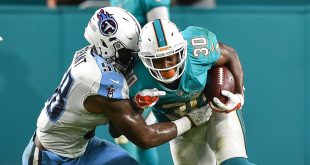 Sep 1, 2016; Miami Gardens, FL, USA; Miami Dolphins running back Daniel Thomas (30) is tackled by Tennessee Titans linebacker Curtis Grant (58) during the second half at Hard Rock Stadium. Tennessee won 21-10. Mandatory Credit: Steve Mitchell-USA TODAY Sports