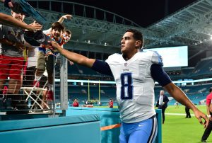 Sep 1, 2016; Miami Gardens, FL, USA; Tennessee Titans quarterback Marcus Mariota (8) hands a fan his baseball cap as he leaves the field after defeating the Miami Dolphins 21-10 at Hard Rock Stadium. Mandatory Credit: Steve Mitchell-USA TODAY Sports