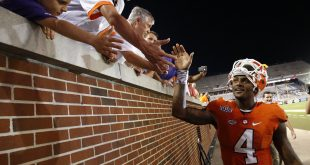 Sep 22, 2016; Atlanta, GA, USA; Clemson Tigers quarterback Deshaun Watson (4) celebrates with fans after their game against the Georgia Tech Yellow Jackets at Bobby Dodd Stadium. The Tigers won 26-7. Mandatory Credit: Jason Getz-USA TODAY Sports