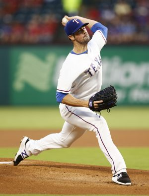Sep 28, 2016; Arlington, TX, USA; Texas Rangers starting pitcher Cole Hamels (35) delivers to the Milwaukee Brewers during the first inning of a baseball game at Globe Life Park in Arlington. Mandatory Credit: Jim Cowsert-USA TODAY Sports