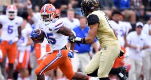 Oct 1, 2016; Nashville, TN, USA; Florida Gators running back Jordan Scarlett (25) runs for a first down during the first half at Vanderbilt Stadium. Mandatory Credit: Christopher Hanewinckel-USA TODAY Sports