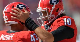 Oct 1, 2016; Athens, GA, USA; Georgia Bulldogs quarterback Jacob Eason (10) reacts with fullback Nick Moore (43) prior to the game against the Tennessee Volunteers at Sanford Stadium. Mandatory Credit: Dale Zanine-USA TODAY Sports