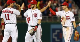 Oct 1, 2016; Washington, DC, USA; Washington Nationals right fielder Bryce Harper (34) and Nationals center fielder Trea Turner (7) celebrate with teammates after their game against the Miami Marlins at Nationals Park. The Nationals won 2-1. Mandatory Credit: Geoff Burke-USA TODAY Sports
