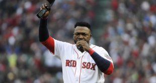 Oct 2, 2016; Boston, MA, USA; Boston Red Sox designated hitter David Ortiz (34) addresses the crowd during pregame ceremonies in his honor prior to a game against the Toronto Blue Jays at Fenway Park. Mandatory Credit: Bob DeChiara-USA TODAY Sports