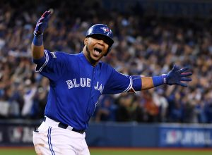 Oct 4, 2016; Toronto, Ontario, CAN; Toronto Blue Jays designated hitter Edwin Encarnacion (10) hits a walk off home run to beat the Baltimore Orioles during the eleventh inning in the American League wild card playoff baseball game at Rogers Centre. Mandatory Credit: Nick Turchiaro-USA TODAY Sports