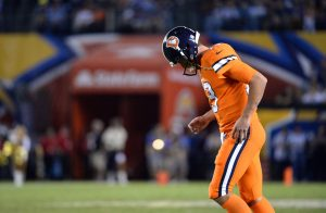 Oct 13, 2016; San Diego, CA, USA; Denver Broncos quarterback Trevor Siemian (13) walks onto the field following a pause in play during the second half of the game against the San Diego Chargers at Qualcomm Stadium. San Diego won 21-13. Mandatory Credit: Orlando Ramirez-USA TODAY Sports