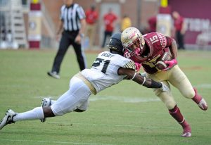 Oct 15, 2016; Tallahassee, FL, USA; Florida State Seminoles wide receiver Travis Rudolph (15) is tackled by Wake Forest Demon Deacons cornerback Essang Bassey (21) during the game at Doak Campbell Stadium. Mandatory Credit: Melina Vastola-USA TODAY Sports